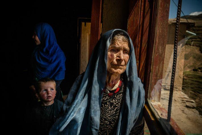 Hafiza gazes out the window of the small home near Faizabad where she took refuge after ...