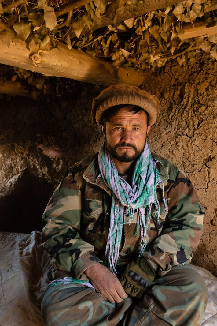 Commander Ayatullah, 48, a former mujahideen fighter, commanded a pro-government militia unit on Karsai Peak that included his 17-year-old ...