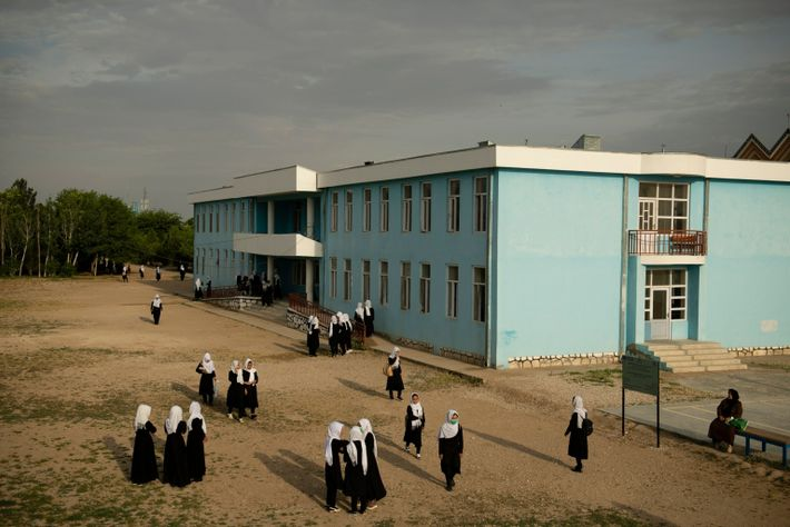 Students gather in the schoolyard of Marshal Dostum High School, in Shibirghan in northwestern Afghanistan on ...