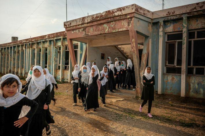 Ethnic minority Uzbek girls emerge from Marshal Dostum High School in the northwestern city of Shibirghan, ...