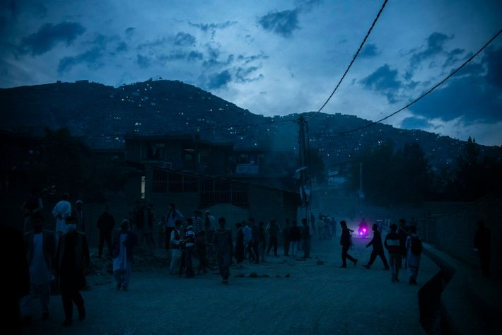 Night falls over the site of an explosion in west of Kabul.