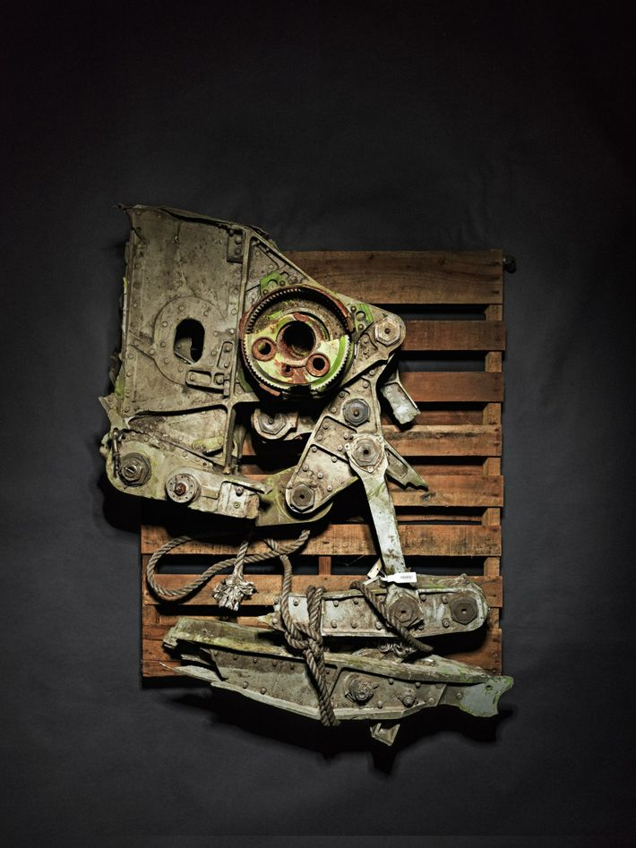 Many of the recovered objects were distorted by force and fire. Investigators identified this fragment as ...