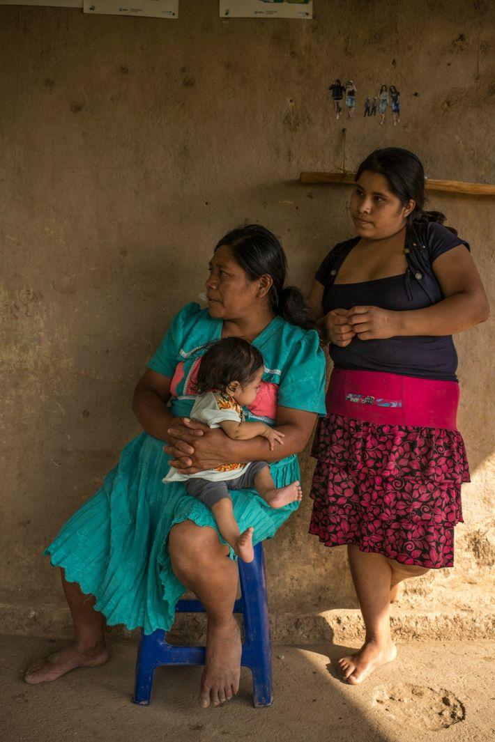 Sebastiana Amador helps her granddaughter, Floria, prepare for her visit to the local nurse. Amador was ...