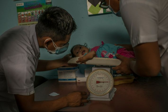 At the hospital in Camotán, Floria is weighed again. A doctor there said he would like ...