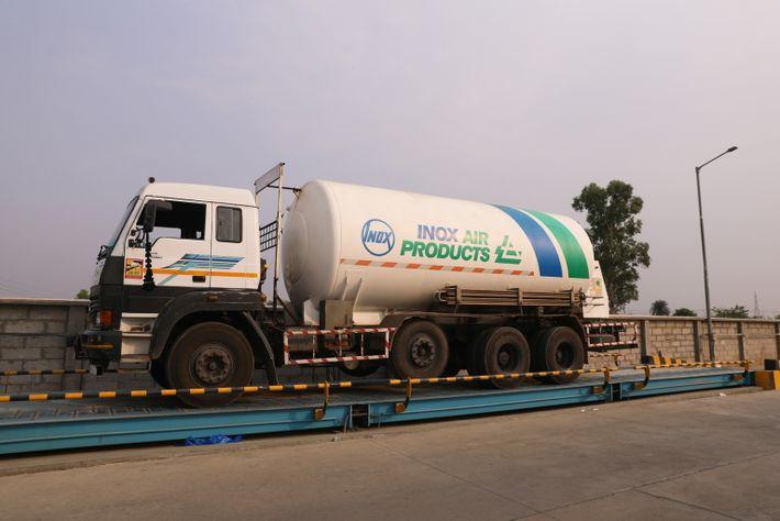 An empty cryogenic oxygen tanker waits outside the oxygen factory in Modinagar, Uttar Pradesh, India, on ...