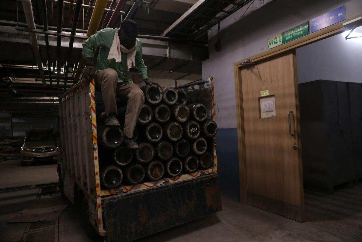 A mini truck waits inside Venkateshwar hospital as workers load up oxygen cylinders in New Delhi, ...