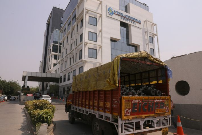 A truck full of oxygen cylinders arrive at Venkatesh hospital in New Delhi, India, on Thursday, ...