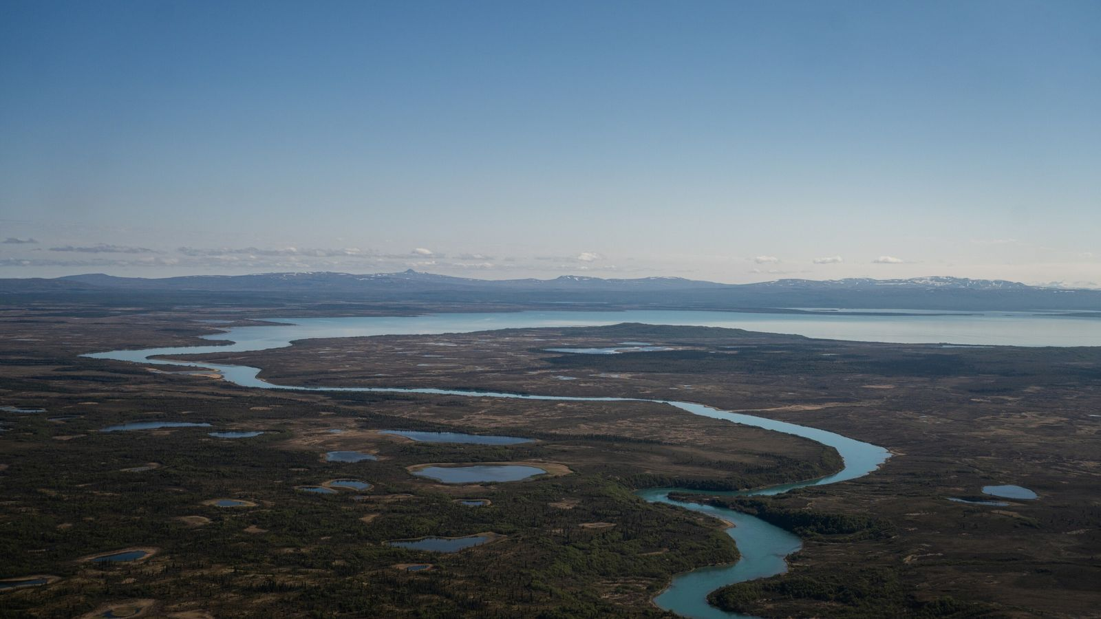 The Naknek River is 35-miles long and flows into Kvichak Bay, an arm of Bristol Bay, ...