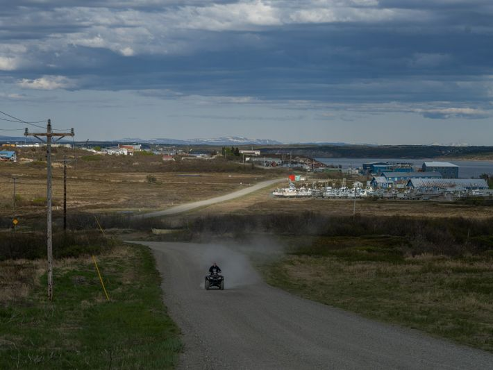 A four-wheeler drives down a road in Naknek, Alaska. During the second season of the pandemic, ...