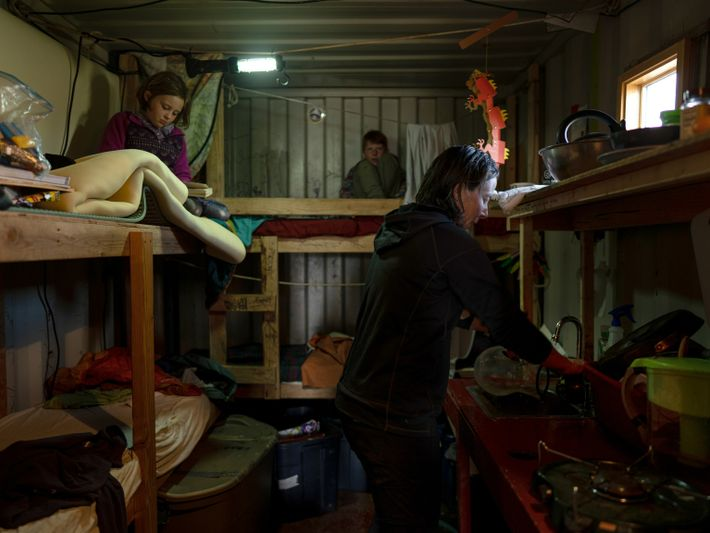 Meghan Gervais cleans up after feeding her children, Margaret and Rubis, in their locker in the ...