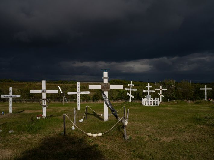A cemetery in Naknek, Alaska, where nets and photographs of fishing adorn some of the graves. ...