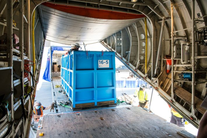 Kharabali, in her crate, is loaded onto the C-130 airplane for the flight to Connecticut.