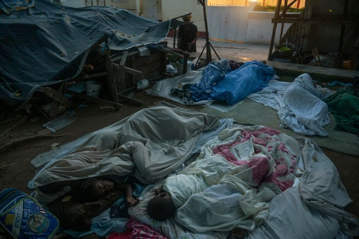 In Corail, families huddle together on mattresses and sheets wrestled from the wreckage of their homes.