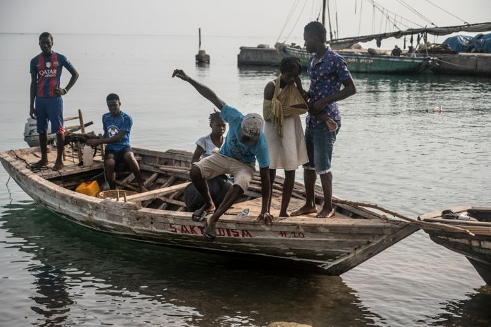Small boats carrying the injured begin to arrive in calm weather for the first time since ...