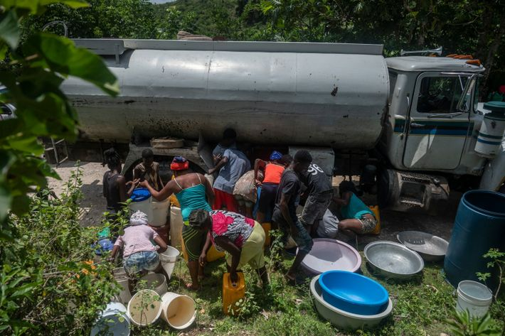 A water truck stops on the main road between Jeremie and Corail to bring water to ...