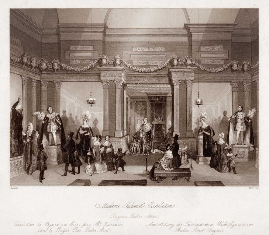 Visitors explore the Tussaud collection in Baker Street, London, where the museum was housed between 1835 ...