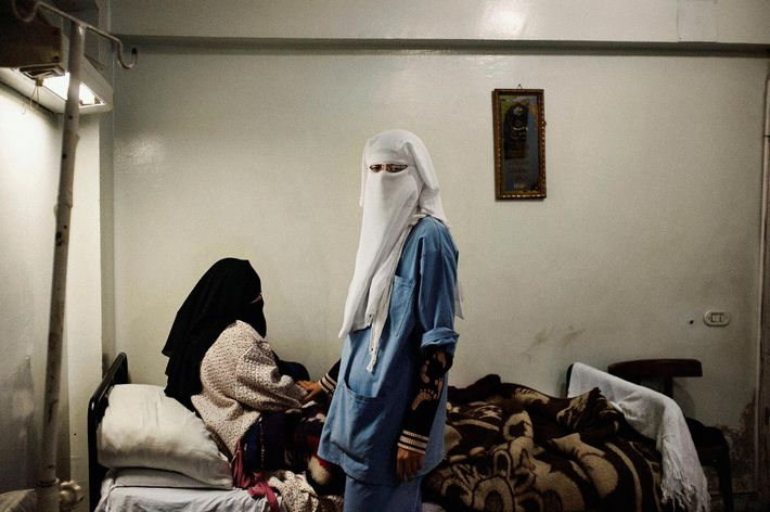 A nurse and her patient at a neighborhood clinic operated by the Muslim Brotherhood. Cairo, Egypt. ...