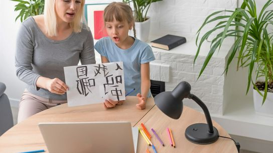 Mom and Daughter - Learning Foreign Languages