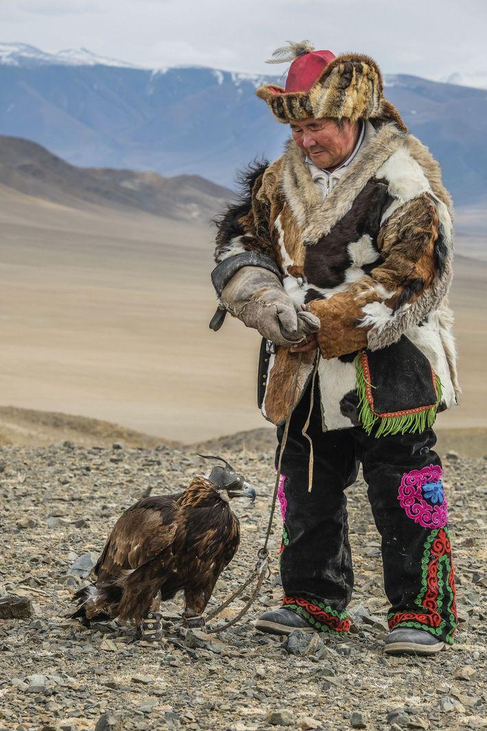 Sailau takes a break with his eagle