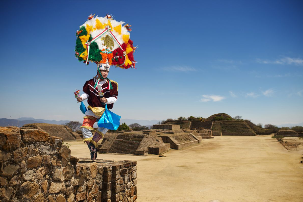 A dancer portrays the Emperor Moctezuma on top of the archaeological site of Monte Albán.