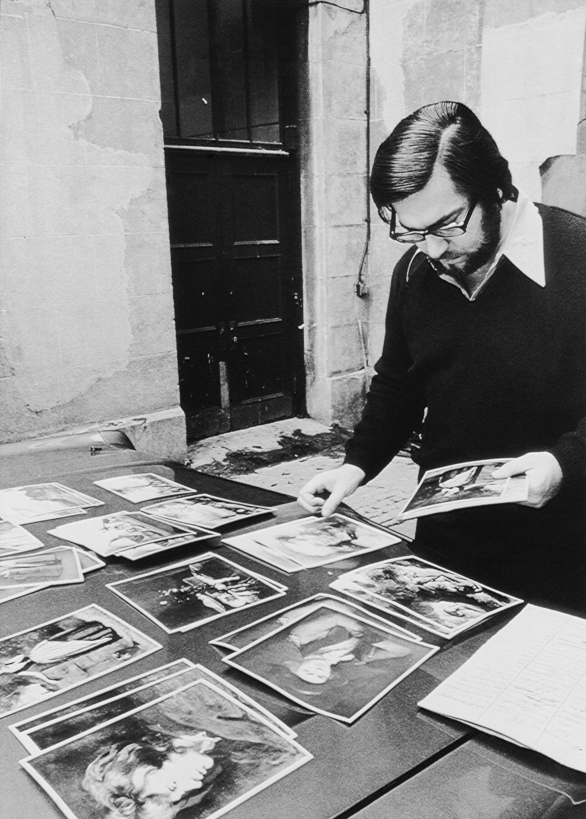 The MMFA's then-Director of Public Relations examines photos of the 18 paintings stolen in the 1972 ...