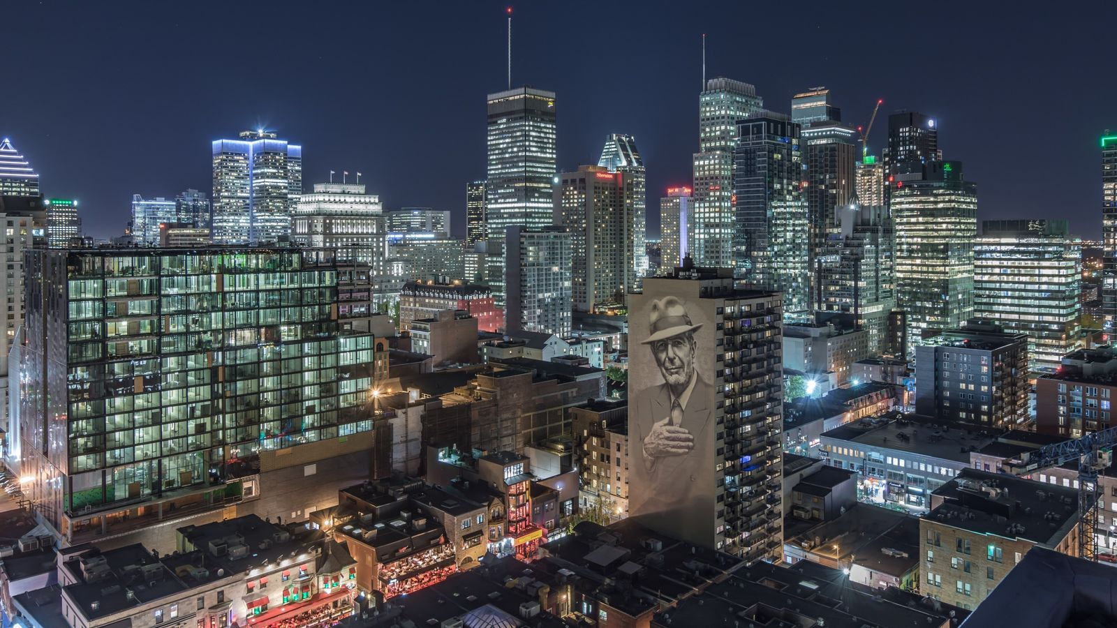 """View of Montreal and of the """"Tower of Songs"""" mural dedicated to the late artist, Leonard ..."""