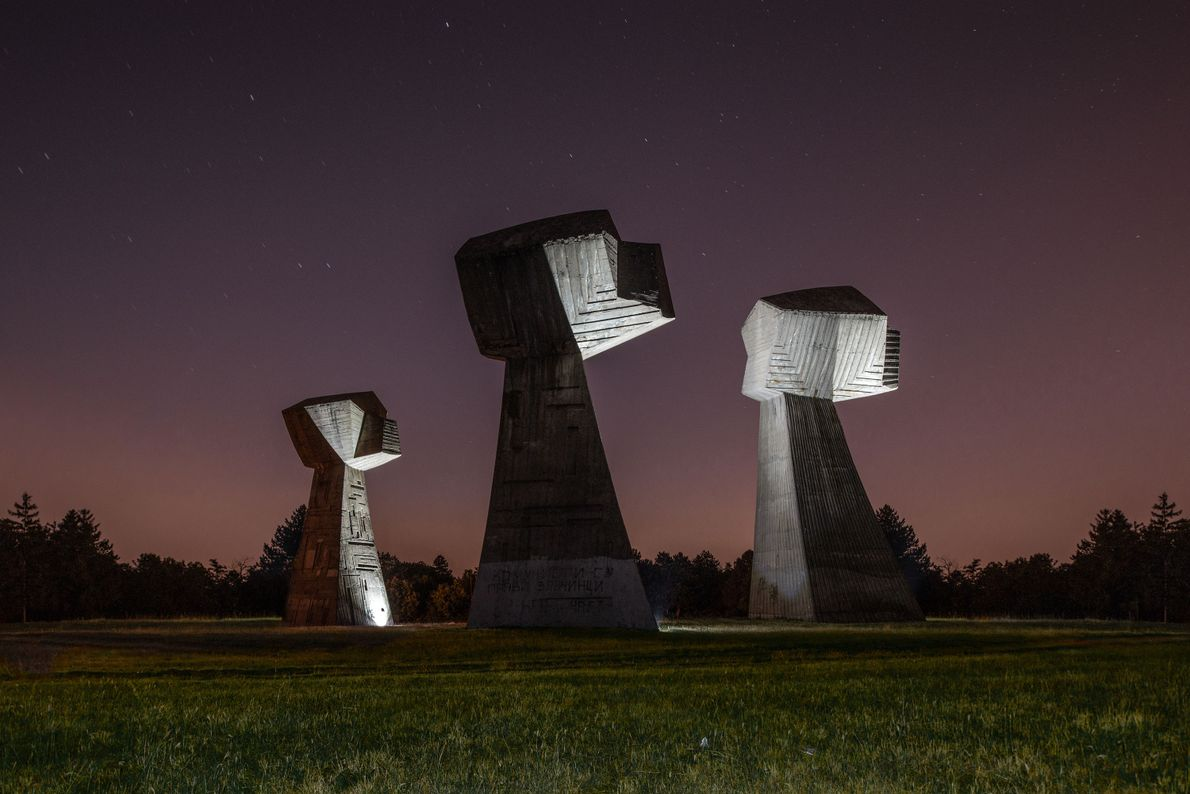 Three fists represent the Serbian, Jewish, and Roma victims killed at this site near Niš, Serbia, ...