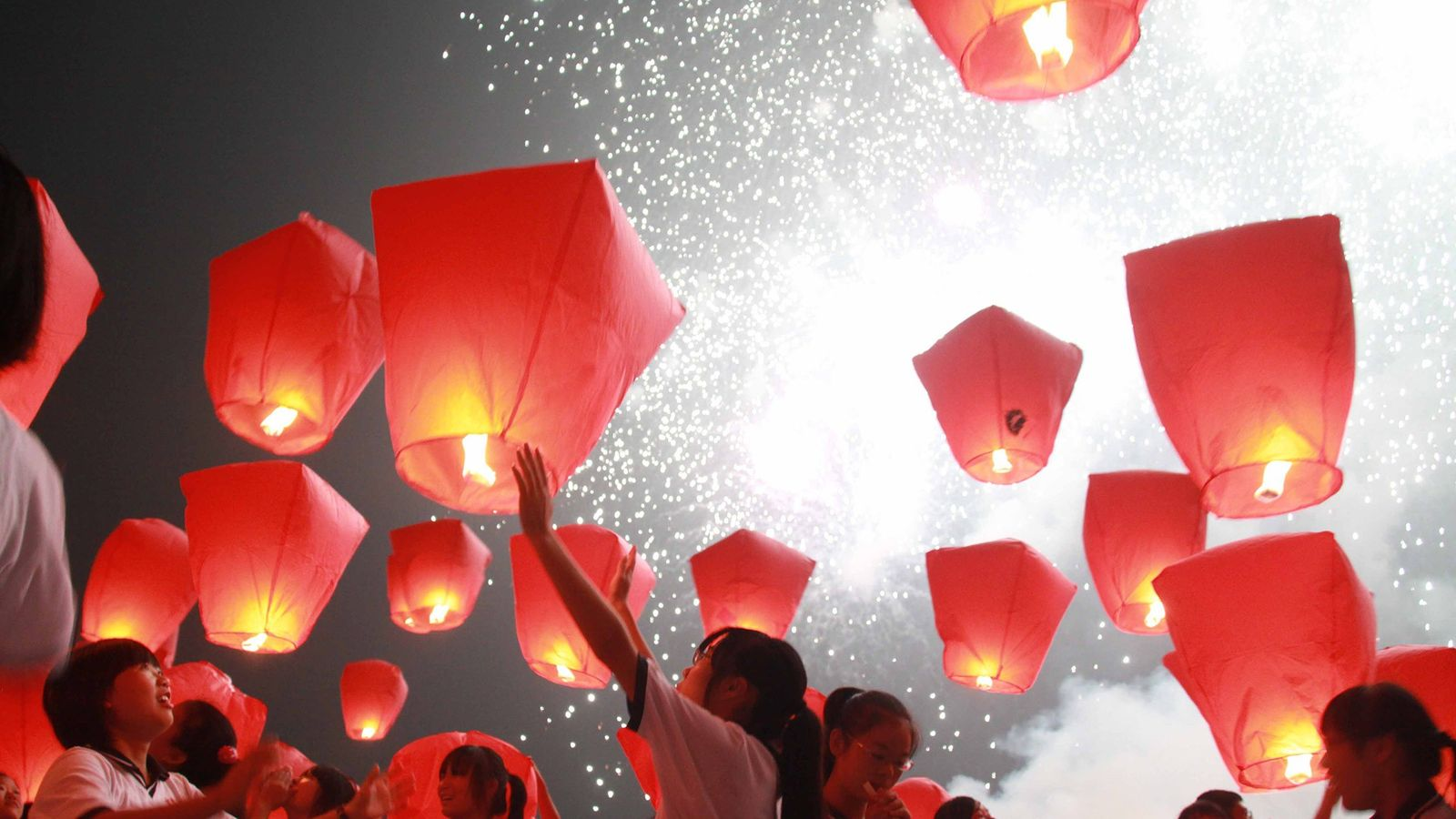 In Yichun, China, a village near Shanghai, locals light up prayer lanterns during the Chinese Moon ...