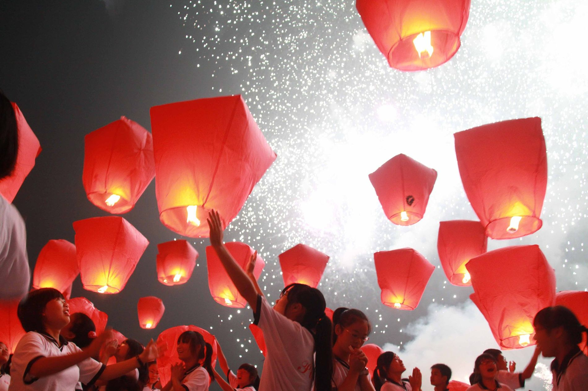 In Yichun, China, a village near Shanghai, locals light up prayer lanterns during the Chinese Moon Festival. The festival falls on September 13 and is celebrated all over China.