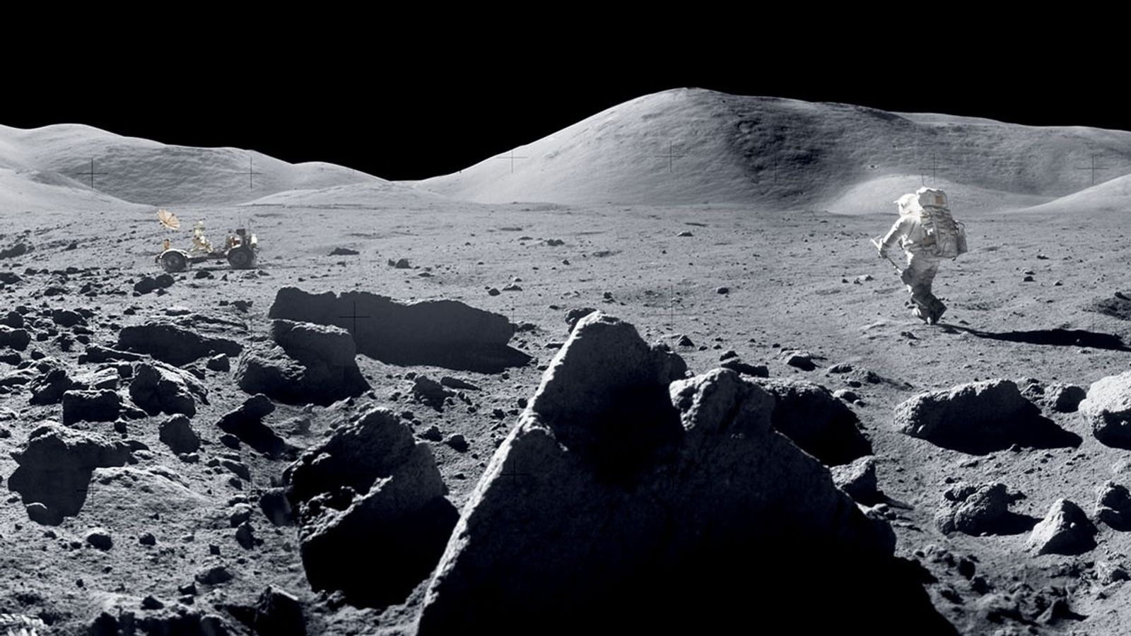Astronaut Harrison Schmitt bounds toward the lunar rover during the Apollo 17 mission in December 1972, ...