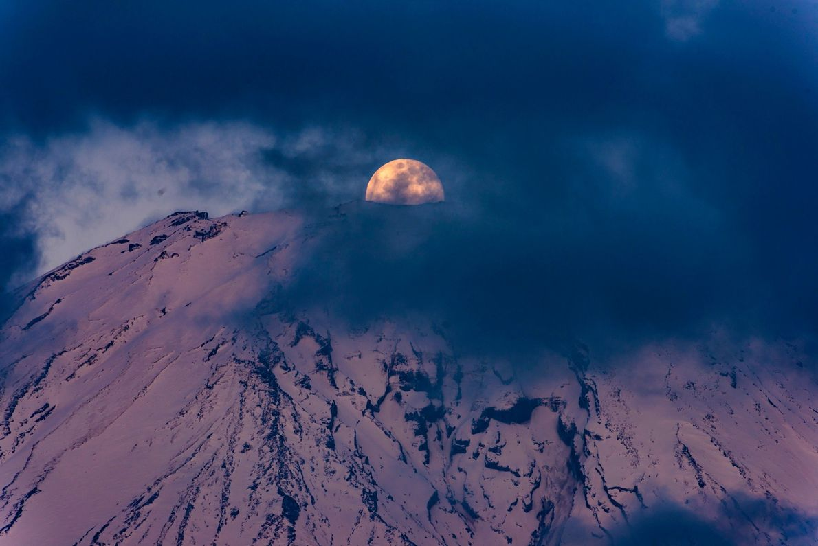 After hours of thick clouds obscured the top of Mount Fuji, a break appeared just as ...