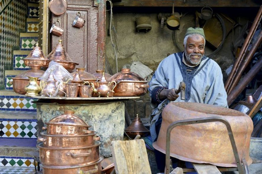 Hamid Filali, a coppersmith at work in the Medina of Fez.
