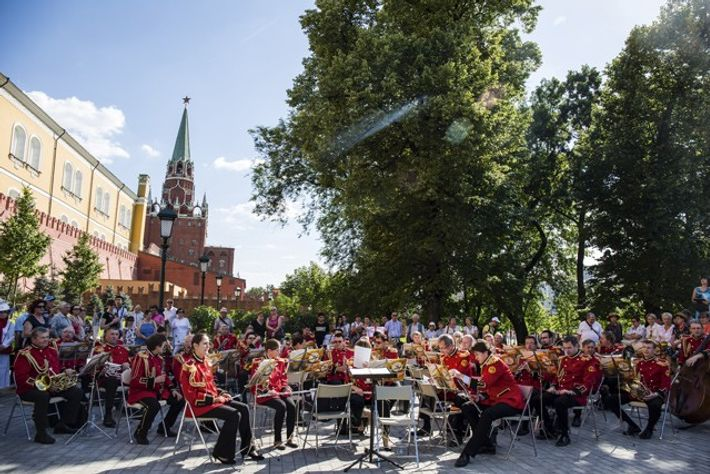 A wind orchestra plays in the small park beside Red Square