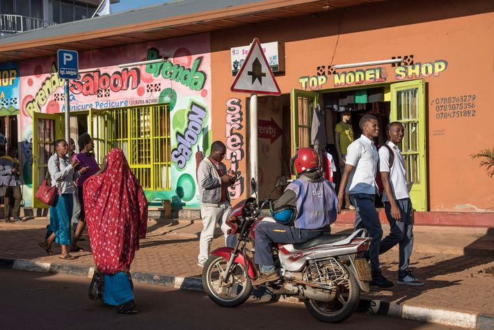 People wander Nyamirambo, a popular and colourful district of Kigali.