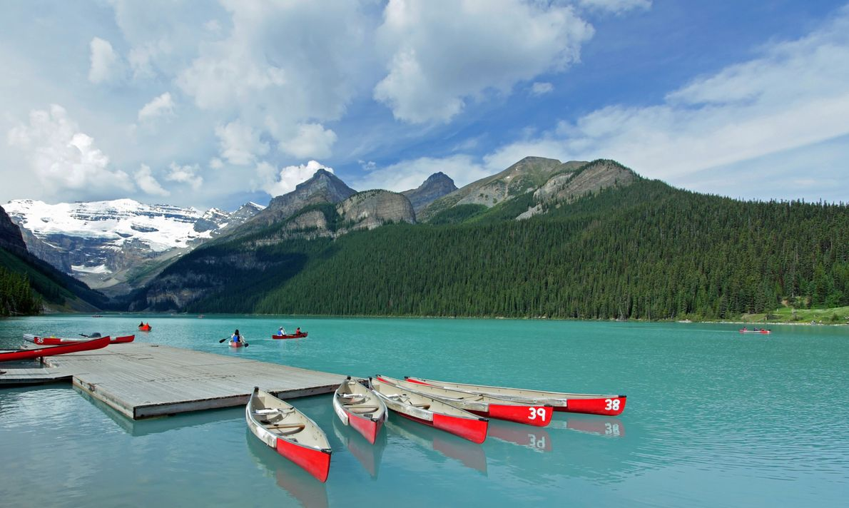 Rent a red canoe on Lake Louise and enjoy the views of Mount Victoria.