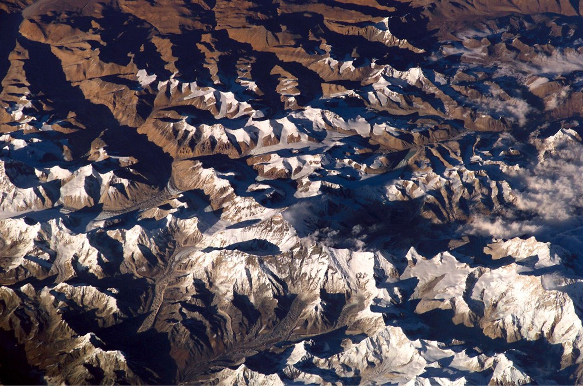 Shadows dance across the Himalaya mountain range in a picture taken by an astronaut on the ...