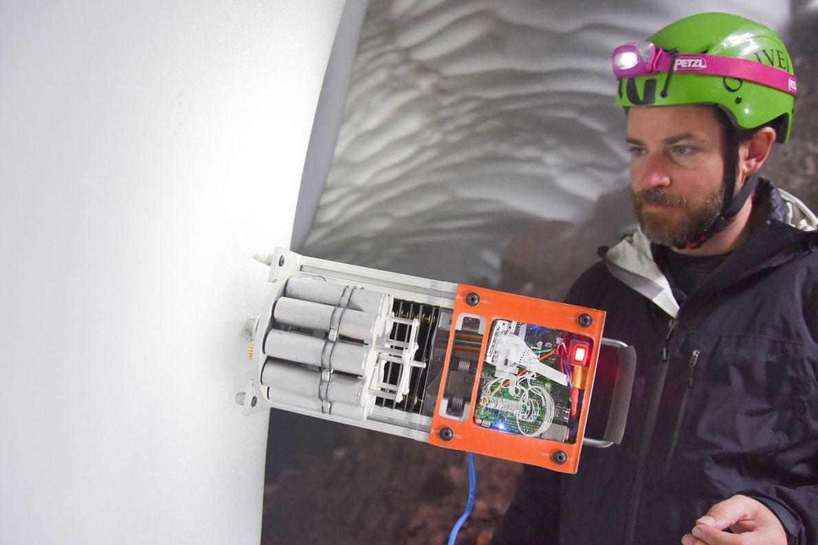 A researcher takes core samples using a robot that is being tested for future use on ...