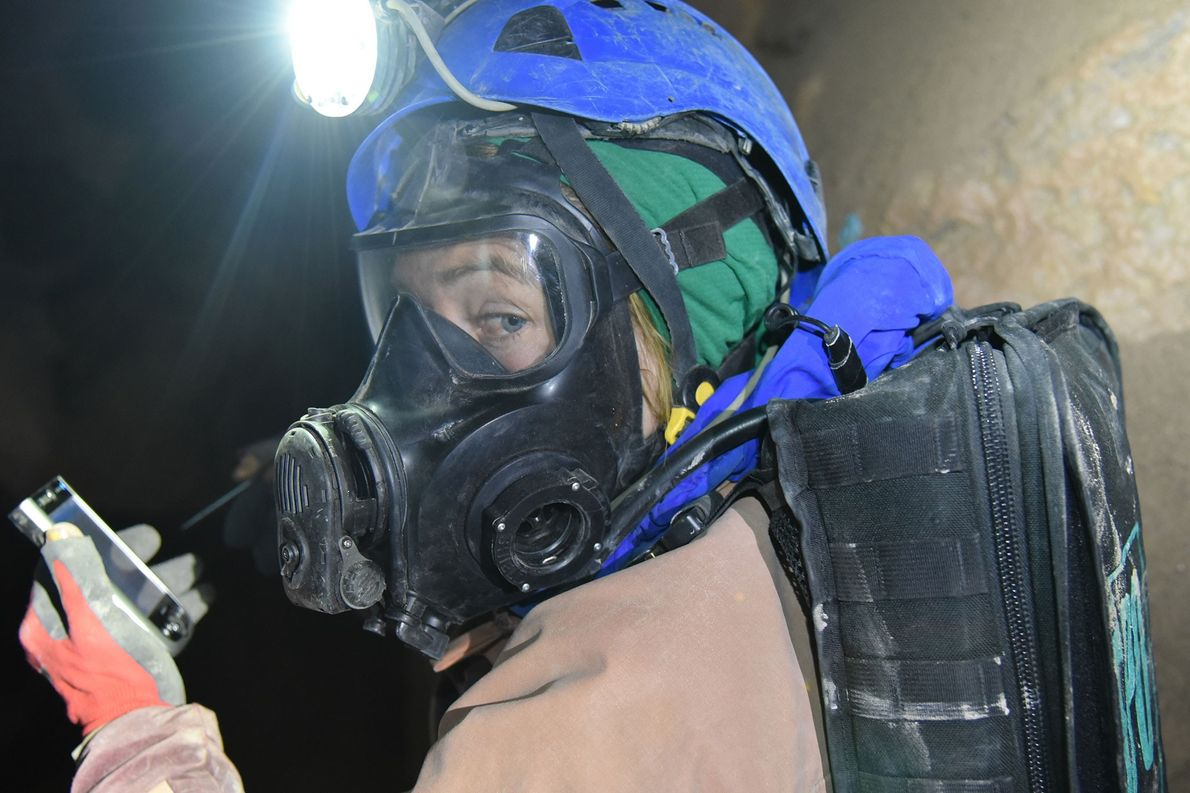 Cave diver Katie Graham moves through a dangerous, gas-filled crater during a final survery of the ...