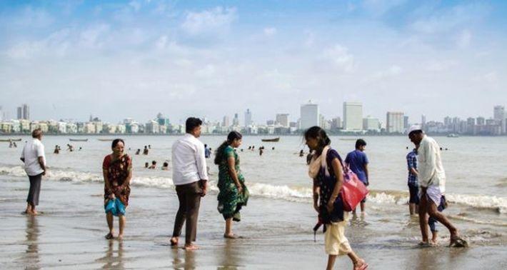 People paddling at the beach, Mumbai