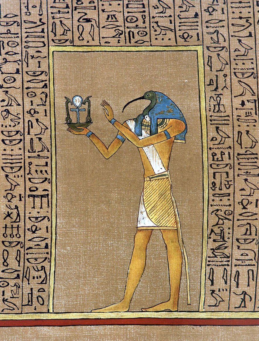 The Egyptian god, Thoth, traditionally portrayed as Ibis-headed, holding an emblem that encloses the Ankh - ...