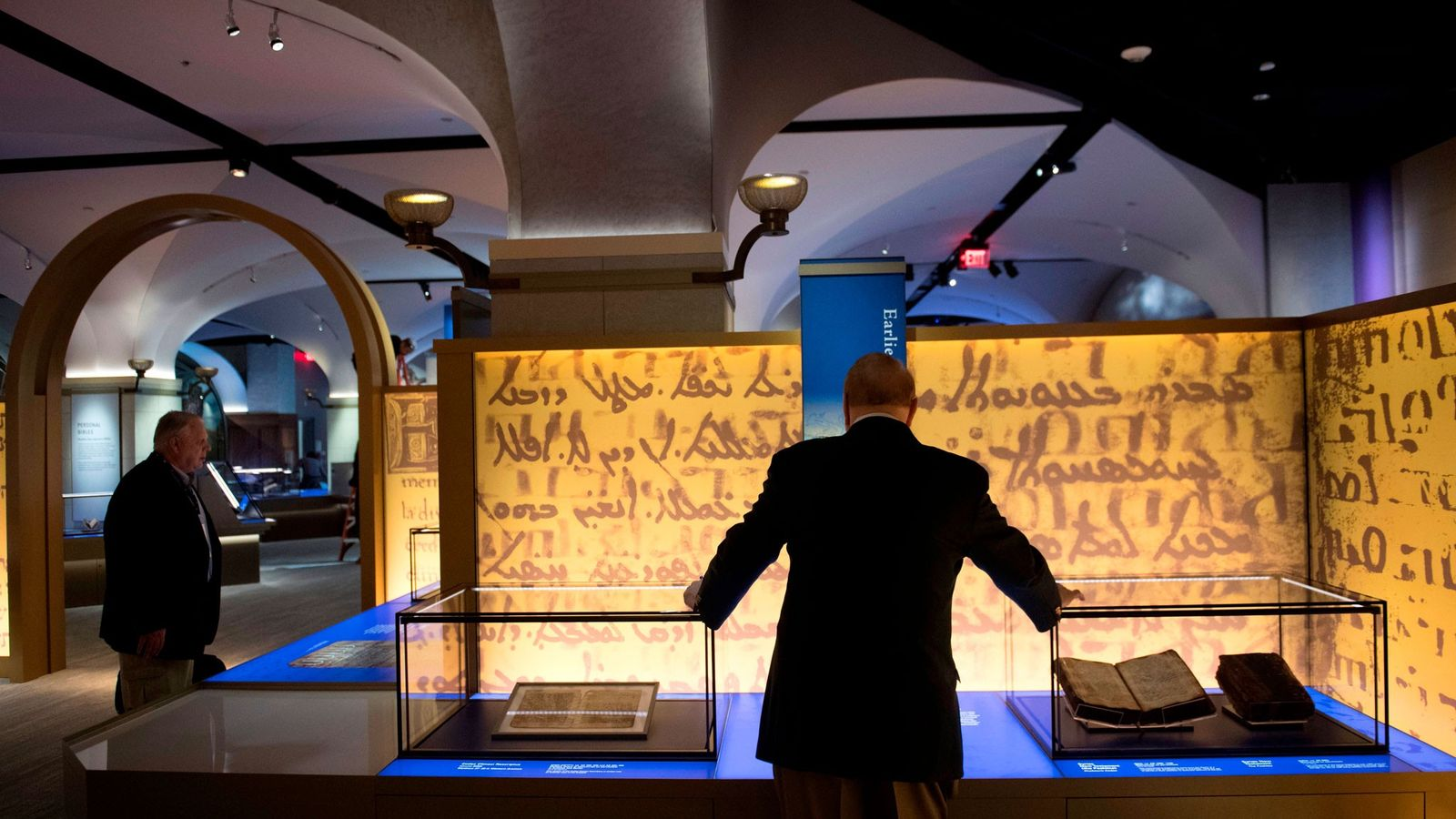 "Visitors tour the ""History of the Bible"" exhibit during a media preview of the new Museum ..."