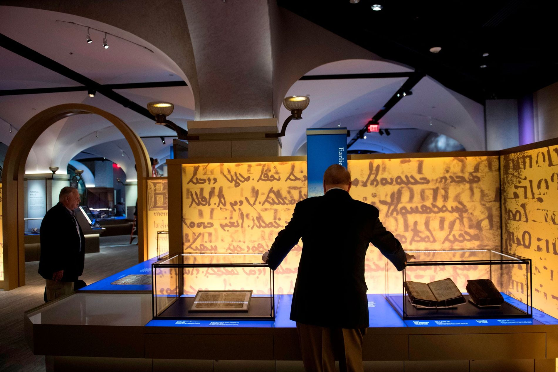 """Visitors tour the """"History of the Bible"""" exhibit during a media preview of the new Museum ..."""