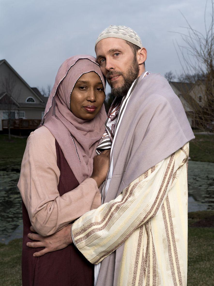 Kamilah Munirah Bolling and Adil Justin Cole stand outside their home in Farmington Hills, Michigan.