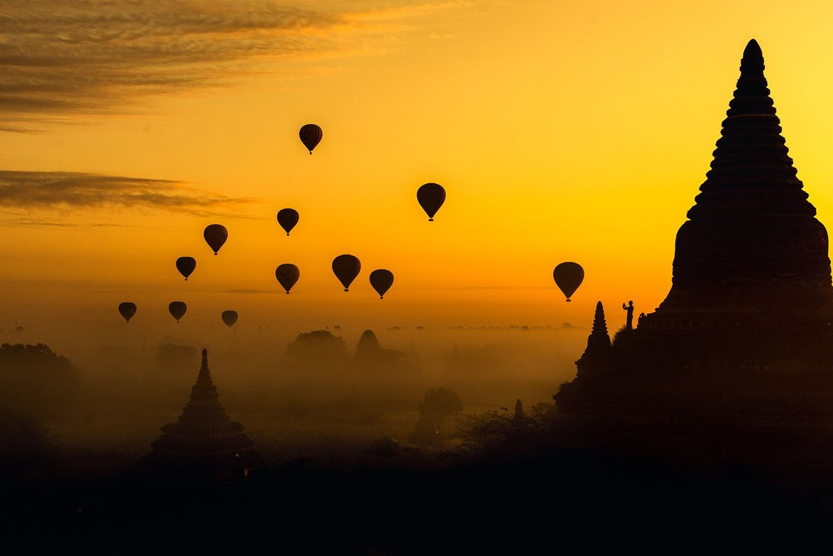 Balloon float at dawn in Myanmar, a UNESCO World Heritage Site.