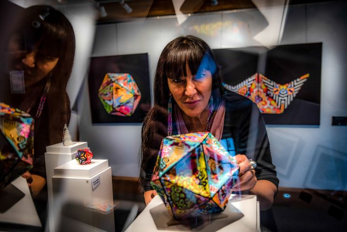Nadine St-Louis, executive director of the Ashukan Cultural Space gallery in Montreal, looks at the work ...