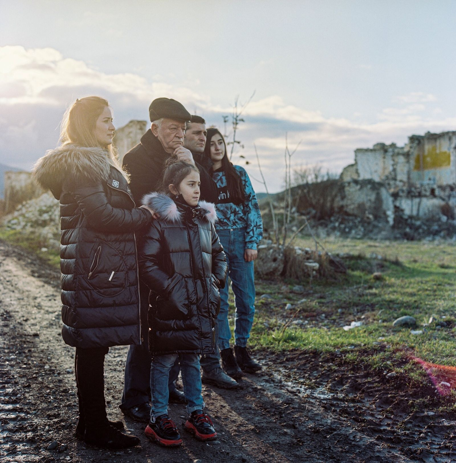 The Guliyev family (left) visited their native village of Qasımlı in Ağdam in search of what ...