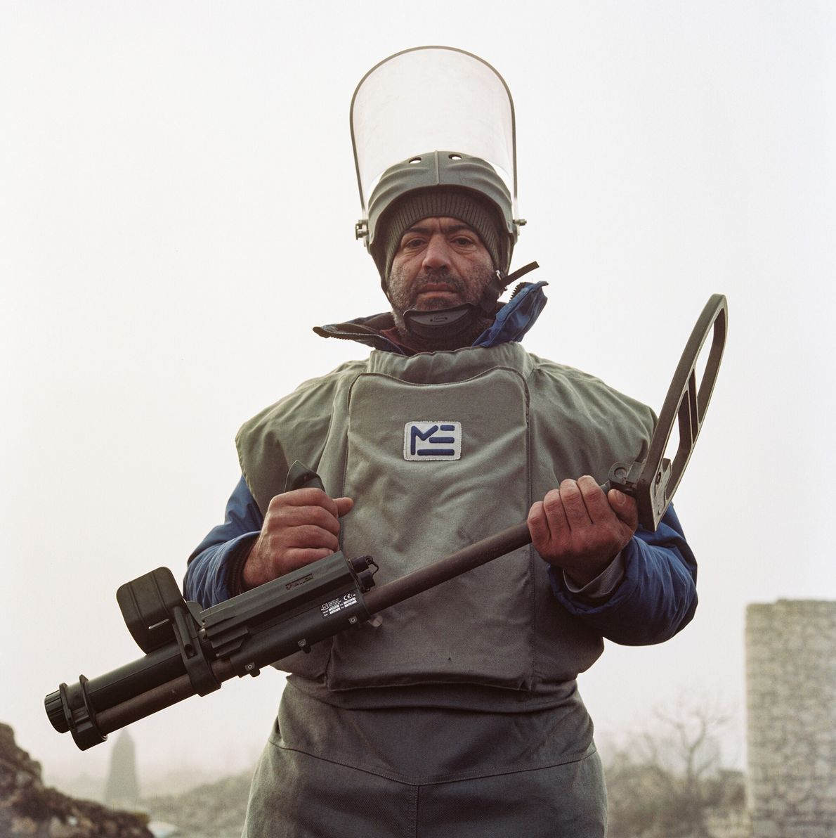 Sahib Mamedov (left) works as a demining agent in the fields of Ağdam. It is slow ...