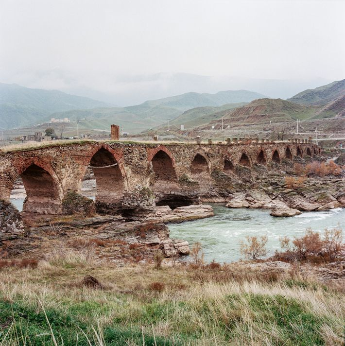 The Khodaafarin Bridge, a 12th-century span on the historic Silk Road, connects Iran with Jabrail, one ...