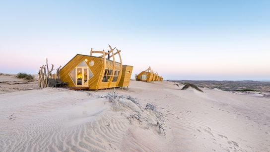 Shipwreck Lodge offers 10 eco-cabins designed to look like washed-ashore boats, Skeleton Coast.