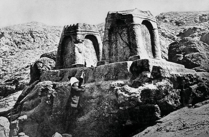 Photographed in the 1880s at the Persian royal necropolis of Naqsh-e Rostam, Jane Dieulafoy stands in ...